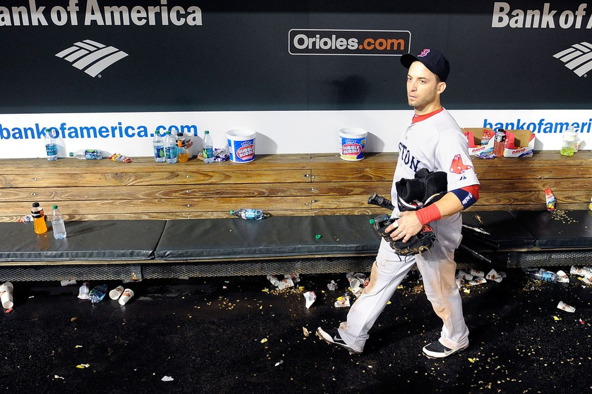 BALTIMORE, MD - SEPTEMBER 28:  Marco Scutaro #10 of the Boston Red Sox walks in the dugout after a 4-3 loss against the Baltimore Orioles at Oriole Park at Camden Yards on September 28, 2011 in Baltimore, Maryland.  (Photo by Greg Fiume/Getty Images)