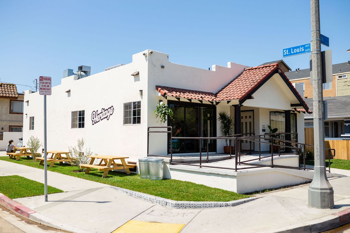 A new restaurant with a side yard patio and Spanish tile.