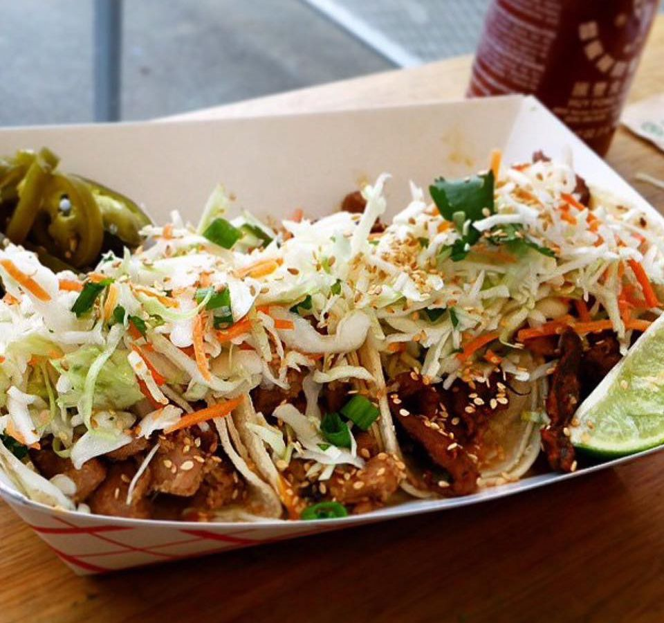 Korean-inspired tacos at Marination in a paper tray.