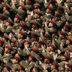 A crowd of North Korean military members clap in a stadium in Pyongyang, North Korea, during a mass meeting called North Korea's ruling party on Saturday, April 14, 2012. North Korea will mark the 100th birth anniversary of the late leader Kim Il Sung on Sunday, April 15.