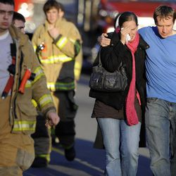 Robbie and Alyssa Parker leave a firehouse staging area following a shooting at the Sandy Hook School in Newtown, Conn. where authorities say a gunman opened fire, leaving 27 people dead, including 20 children, Friday, Dec. 14, 2012.  (AP Photo/Jessica Hill)