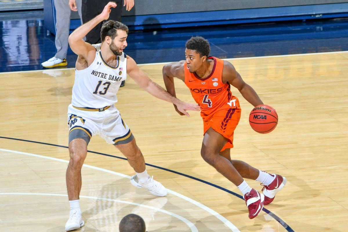 Virginia Tech Hokies guard Nahiem Alleyne dribbles as Notre Dame Fighting Irish guard Nikola Djogo defends in the first half at the Purcell Pavilion.