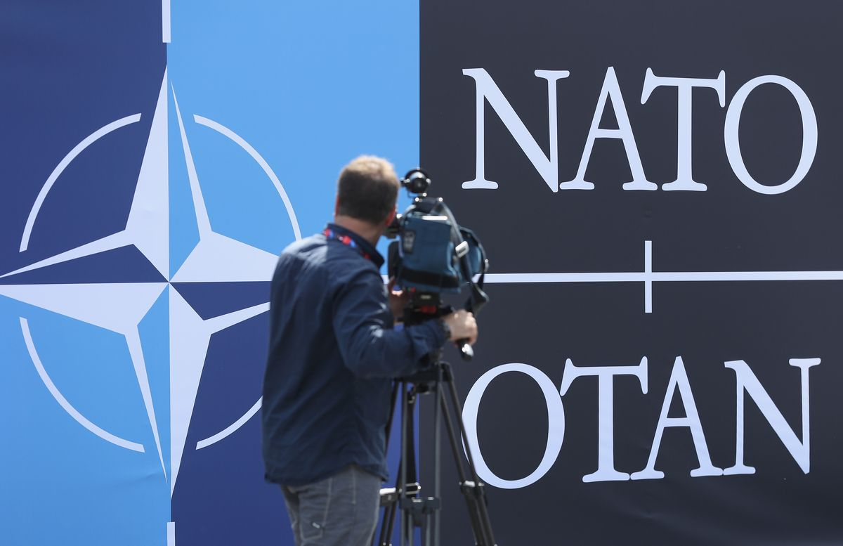 A television cameraman films the NATO logo outside the PGE National Stadium, site of the NATO summit, on July 8, 2016 in Warsaw, Poland.