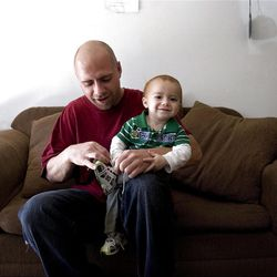 Mike DeBoer and his son, Lucius, get ready to play outside in Ogden on Thursday, May 12, 2011.