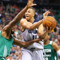 Utah's Dante Exum is fouled by Eric Buckner on a drive into the lane as the Utah Jazz and Boston Celtics play Monday, July 6, 2015, in Summer League action at EnergySolutions Arena.