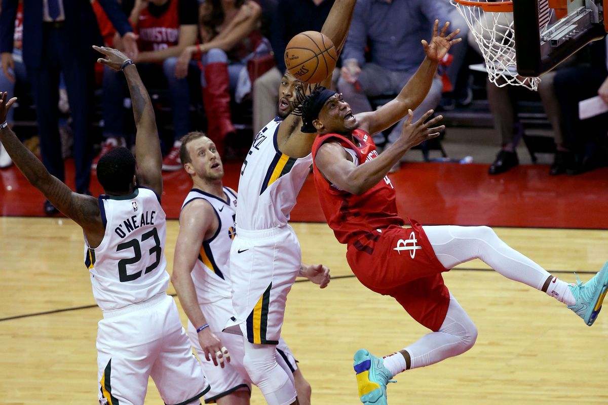 Houston Rockets forward Danuel House Jr. (4) and Utah's Derrick Favors compete for the rebound during Game 5 of a first-round NBA basketball playoff series in Houston on Wednesday, April 24, 2019.