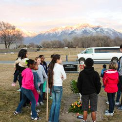 The Walker children gather around their brother Gideon's grave. The Walkers adopted 3-year-old Gideon in 2013, knowing that he had severe heart problems, and had him for 10 months before he passed away.