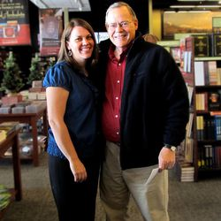Gerald Lund supports his daughter Rebecca Belliston during a book signing at a Deseret Book store.