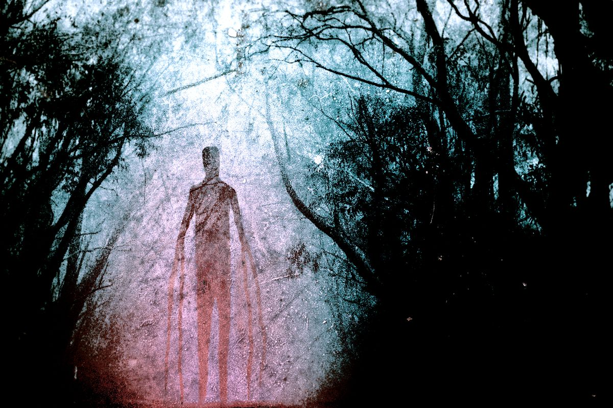 Slender Man in the shadows of a forest