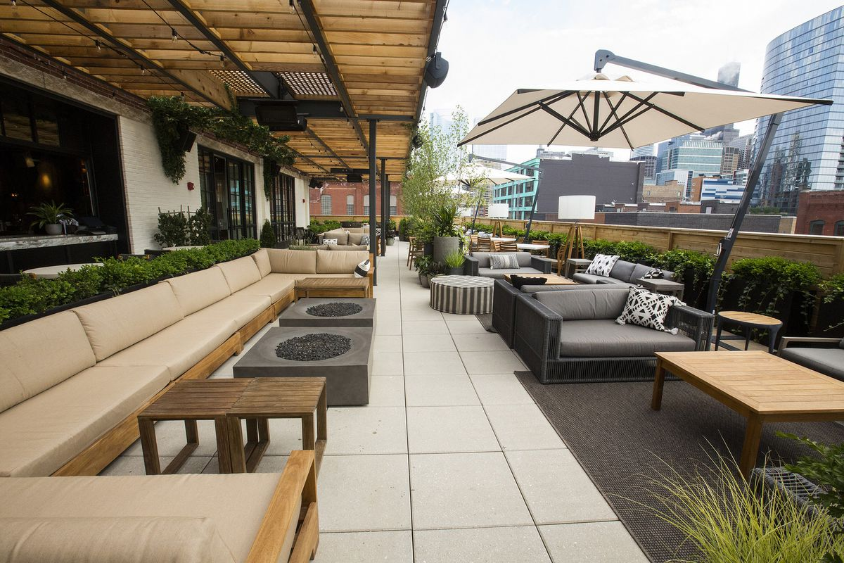 An expansive restaurant rooftop space