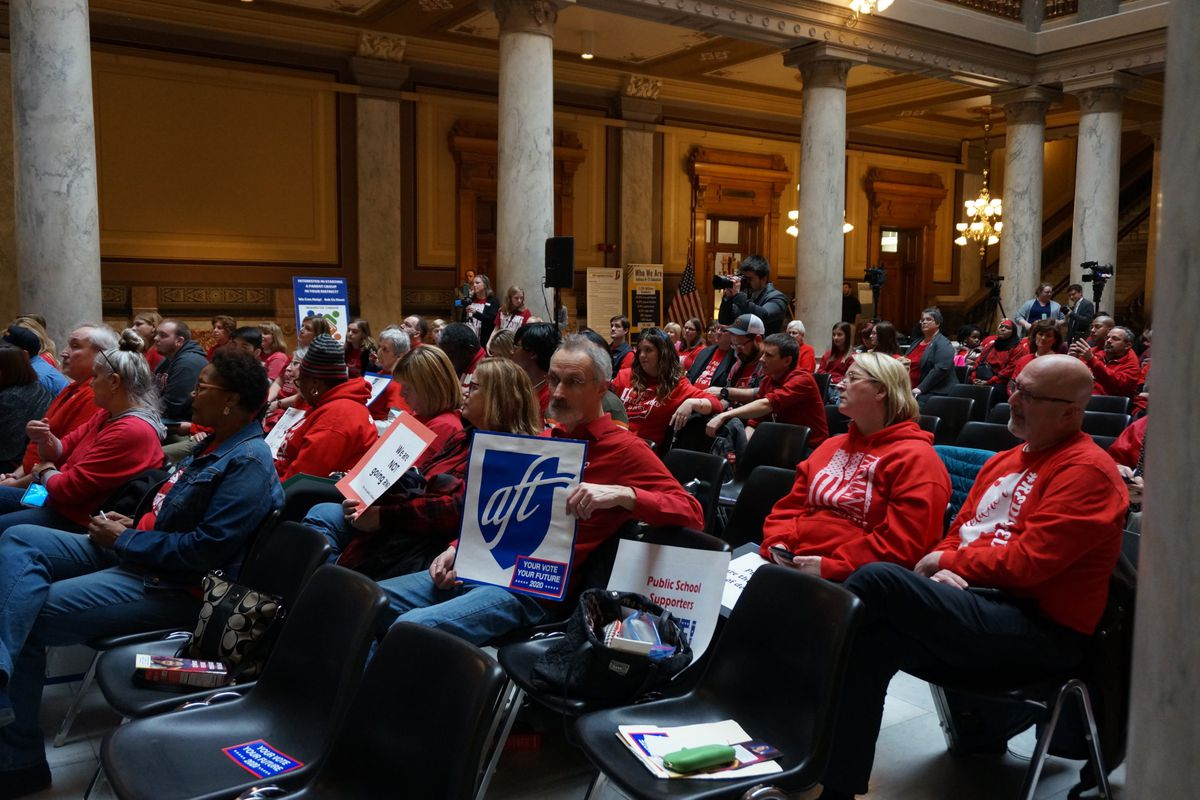 About 100 people gathered for a rally at the Indiana Statehouse in support of increasing funding for traditional public schools.