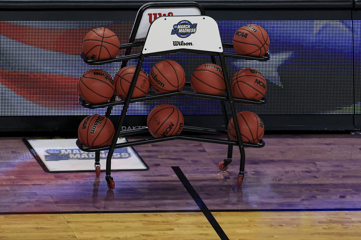 A view of the game balls and NCAA logo and March Madness logo and court floor before the game between the Kansas Jayhawks and the Eastern Washington Eagles during the first round of the 2021 NCAA Tournament at Indiana Farmers Coliseum.