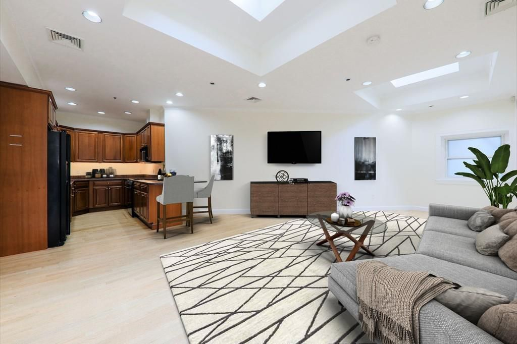 A spacious open living room with an open kitchen.