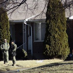 Law enforcement officers and crime scene investigators continue to work at the scene of an overnight shooting at a home in Ogden Thursday, Jan. 5, 2012.  Six officers, some from the Weber-Morgan Narcotics Strike Force were shot while serving a warrant at 3268 Jackson Ave.