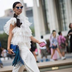 """Marta of <a href=""""http://www.itssuperfashion.com""""target=""""_blank"""">It's Super Fashion</a> is wearing an Audra top and pants, Karen Walker sunglasses, a Sara Battaglia bag and Jerome C. Rousseau shoes."""