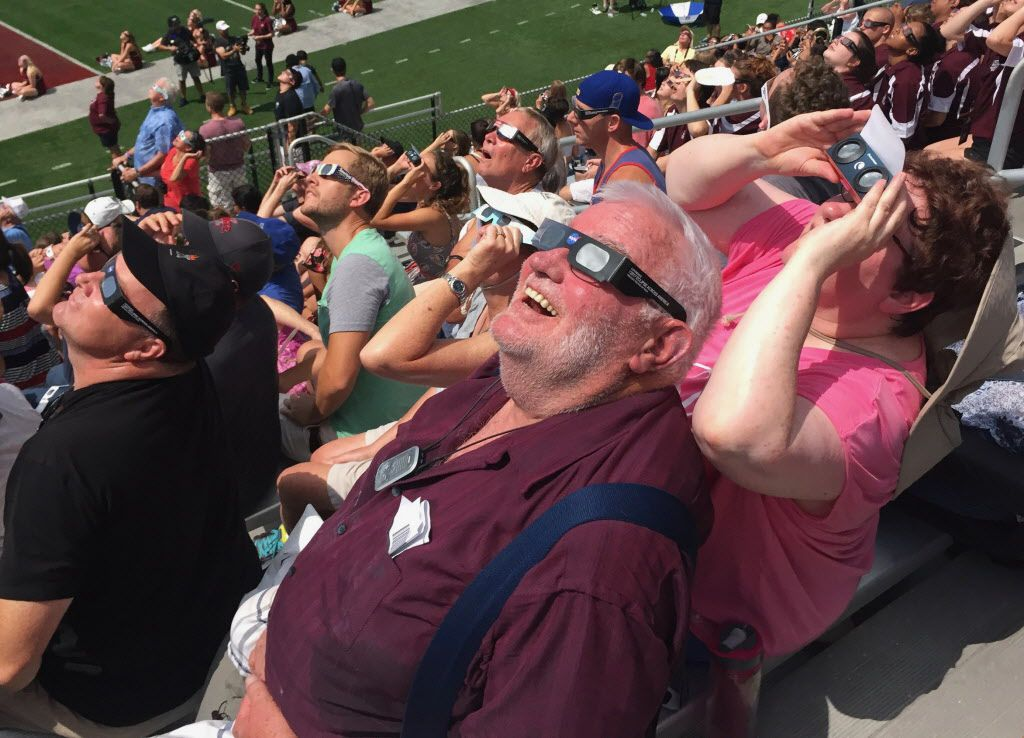 """Ed Hill, an engineer from Barrington, with his girlfriend June Mannion, a pediatrician, viewing the eclipse. """"It's bucket list,"""" said Hill. 