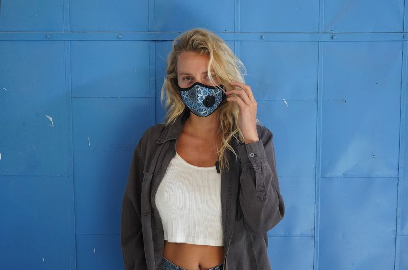 A woman in a printed blue Vogmask.