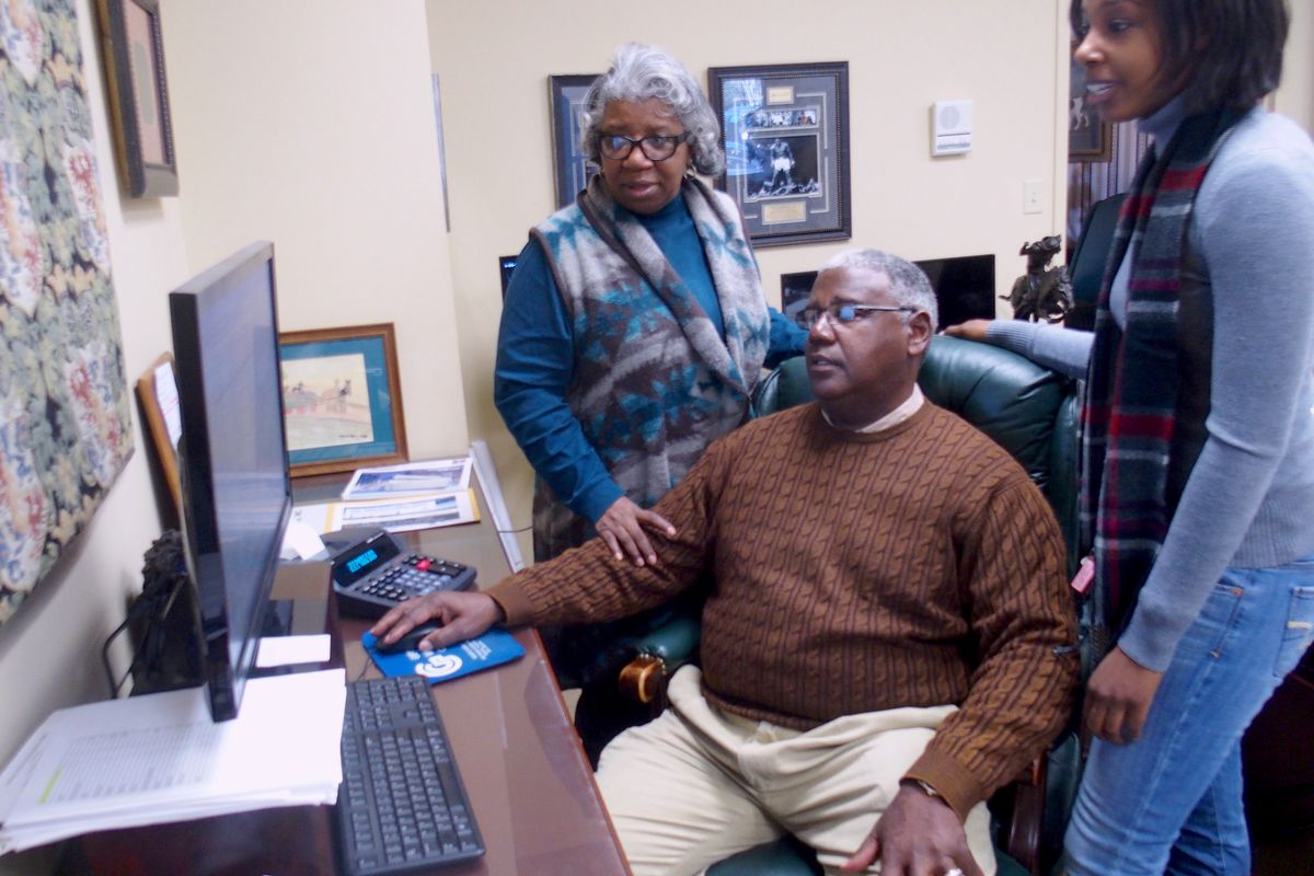 Winston Gipson confers with his wife and daughter, who help run Gipson Mechanical Contractors, a family-owned business in Memphis for 35 years.
