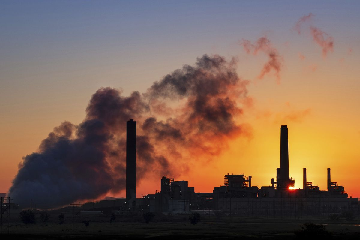 FILE - In this July 27, 2018, file photo, the Dave Johnson coal-fired power plant is silhouetted against the morning sun in Glenrock, Wyo. The Trump administration on Friday targeted an Obama-era regulation credited with helping dramatically reduce toxic