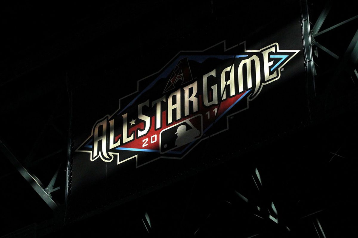 PHOENIX, AZ - JULY 12:  Light cuts across an All-Star Game banner during the 82nd MLB All-Star Game at Chase Field on July 12, 2011 in Phoenix, Arizona.  (Photo by Christian Petersen/Getty Images)