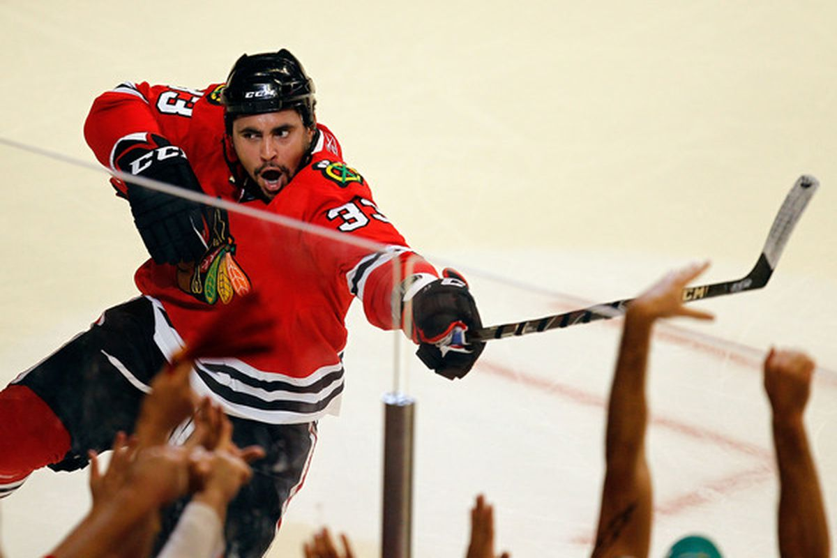 Dustin Byfuglien shows the way to the Stanley Cup Finals for the Chicago Blackhawks  (Photo by Jonathan Daniel/Getty Images)