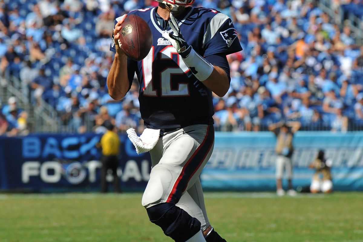 Sep 09, 2012; Nashville, TN, USA; New England Patriots quarterback Tom Brady (12) rolls out to pass against the Tennessee Titans during the second half at LP Field. The Patriots beat the Titans 34-13. Mandatory credit: Don McPeak-US PRESSWIRE