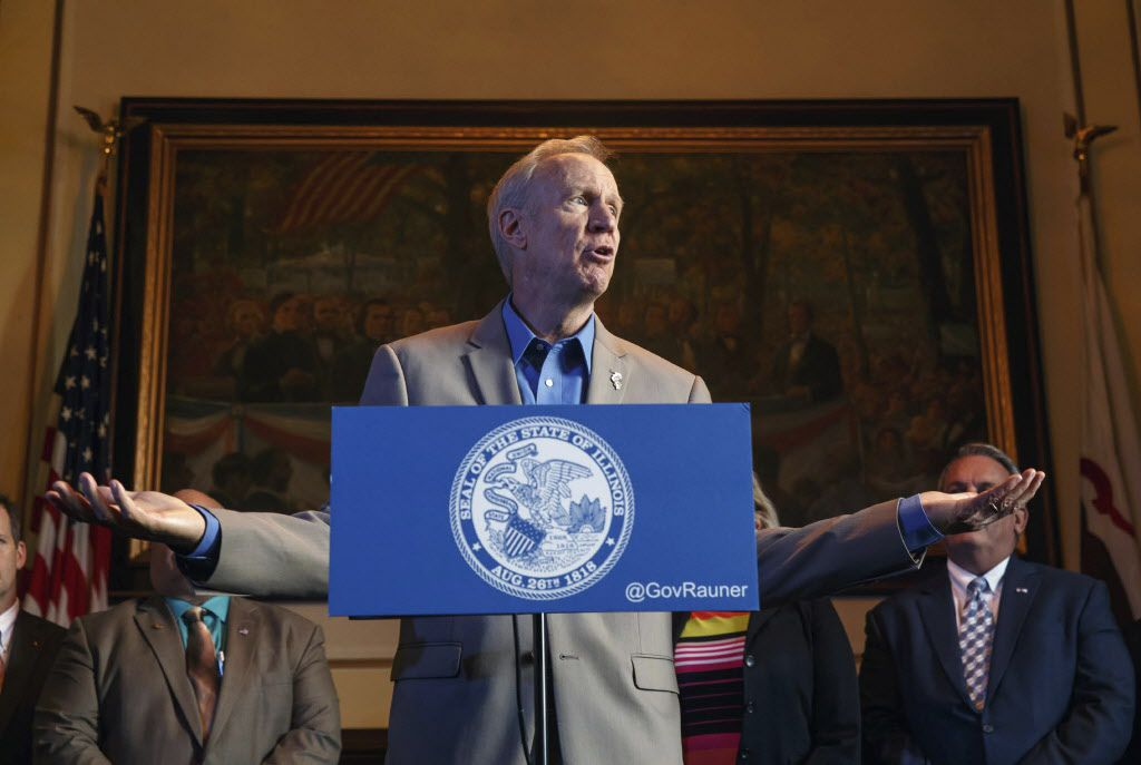 Gov. Bruce Rauner calls on Illinois Senate President John Cullerton, D-Chicago, to send Senate Bill 1 to his desk as he is surrounded by members of the Republican caucus during a news conference on the first day of a special session on education funding a