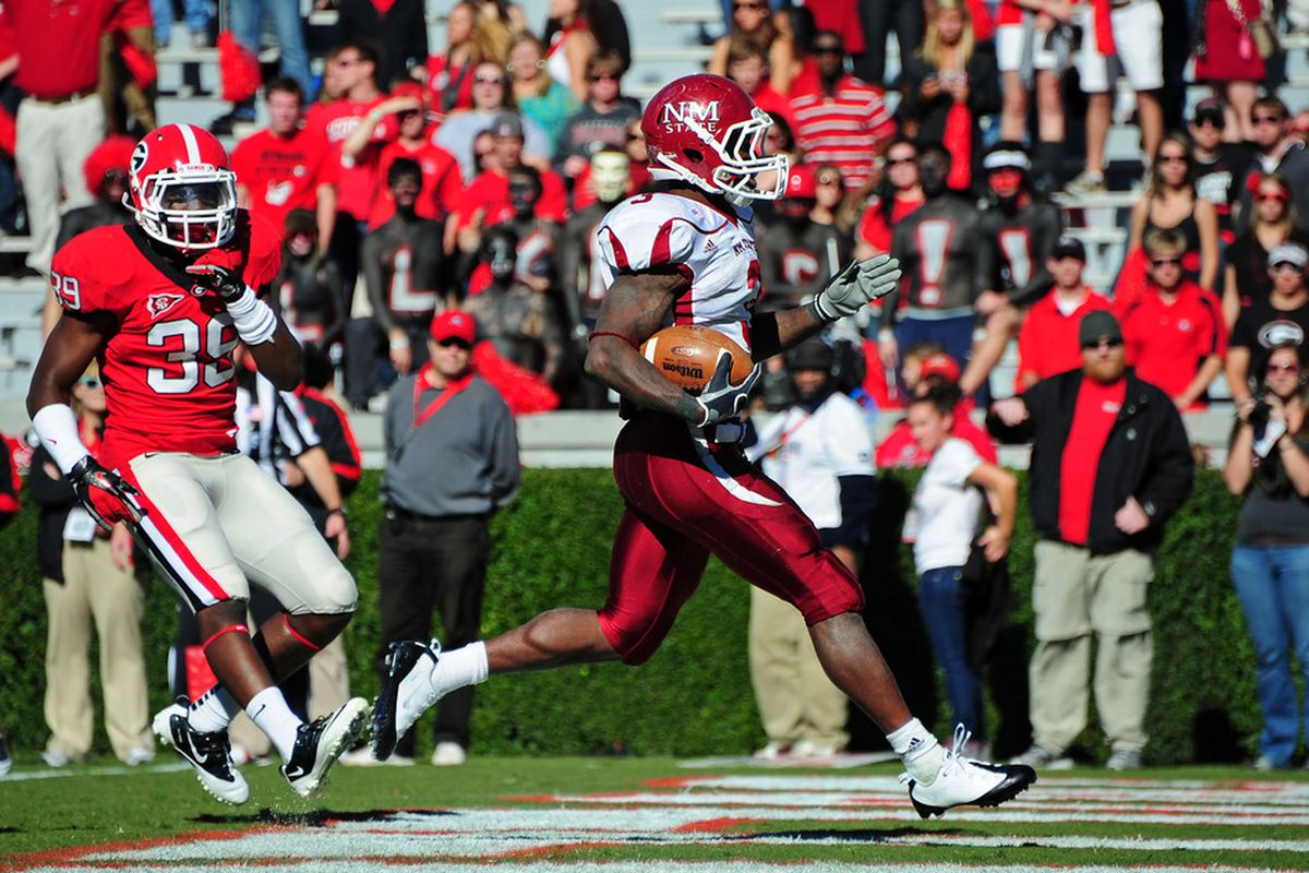 ATHENS, GA - NOVEMBER 5: Kenny Turner #3 of the New Mexico State Aggies scores a touchdown against the Georgia Bulldogs at Sanford Stadium on November 5, 2011 in Athens, Georgia. Photo by Scott Cunningham/Getty Images)