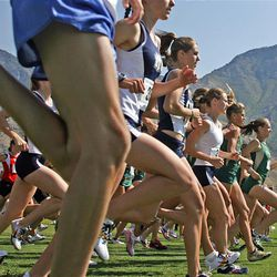 Competitors compete in the BYU Autumn Classic women's 5K run at East Bay Golf Course in Provo.