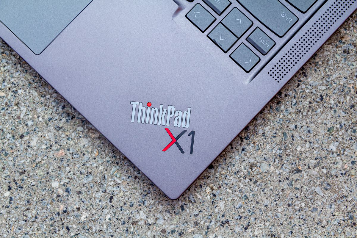 The ThinkPad X1 logo on the ThinkPad X1 Yoga Gen 6 seen from above on a stone table.
