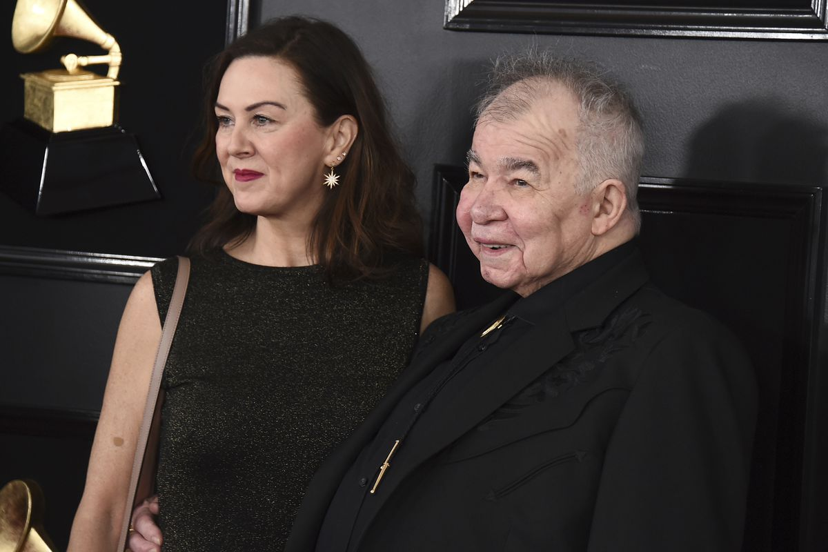 Fiona Whelan Prine and John Prine arrive at the 61st annual Grammy Awards in Los Angeles in 2019.