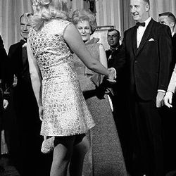In this March 12, 1969 file photo, Joan Kennedy, wife of Sen. Edward Kennedy, D-Mass., shakes hands with Mrs. Judy Agnew, wife of then Vice President  Spiro Agnew, during a reception for members of congress at the White House in Washington.