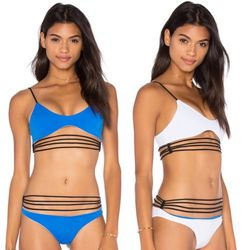 The best part about KOA's strappy, sexy bikini set? It's reversible, so you get two for the price of one.