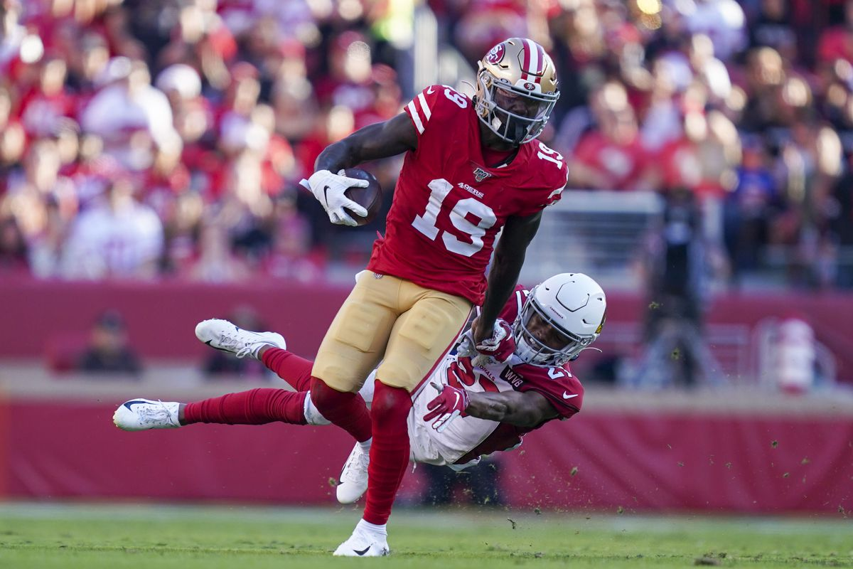 San Francisco 49ers wide receiver Deebo Samuel is tackled by Arizona Cardinals cornerback Kevin Peterson during the third quarter at Levi's Stadium.