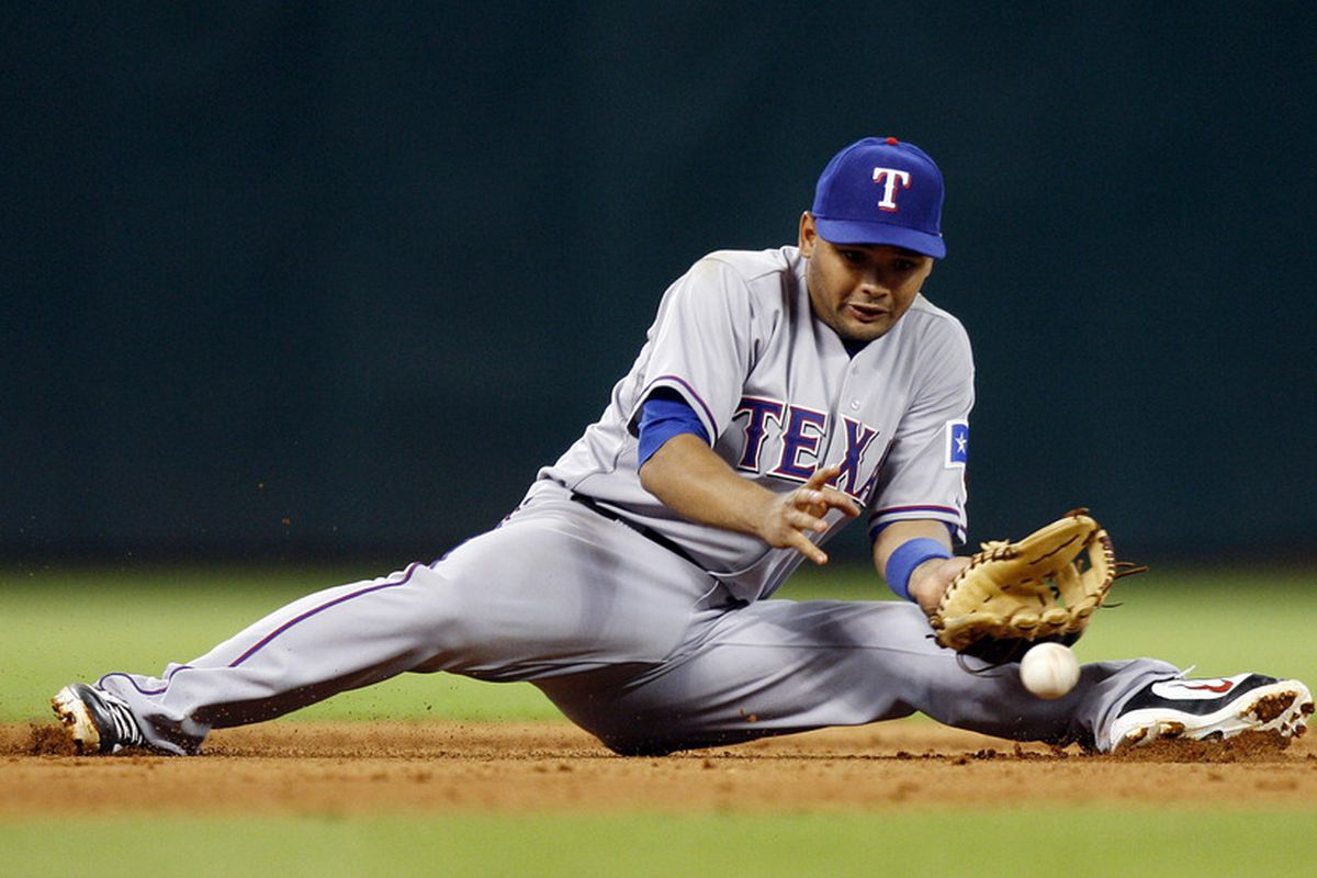 HOUSTON - JUNE 28:  Shortstop Andres Blanco #3 of the Texas Rangers makes a play from a sitting position in the seventh inning against the Houston Astros at Minute Maid Park on June 28, 2011 in Houston, Texas.  (Photo by Bob Levey/Getty Images)