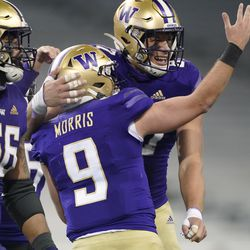 Washington quarterback Dylan Morris (9) celebrates with tight end Cade Otton, right, after Morris passed to Otton for a touchdown against Utah in the final minute of an NCAA college football game Saturday, Nov. 28, 2020, in Seattle. Washington won 24-21.