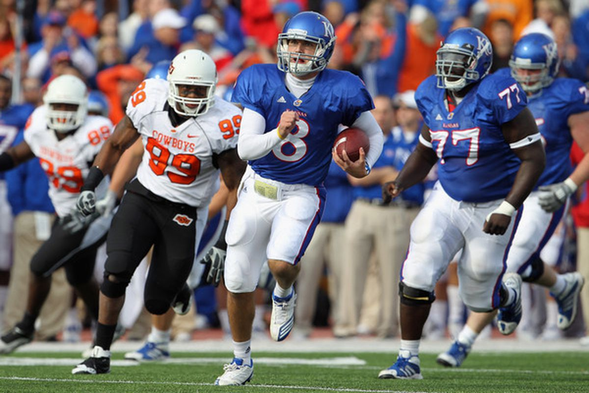 LAWRENCE KS - NOVEMBER 20:   Quarterback Quinn Mecham #8 of the Kansas Jayhawks scrambles during the game against the Oklahoma State Cowboys on November 20 2010 at Memorial Stadium in Lawrence Kansas.  (Photo by Jamie Squire/Getty Images)