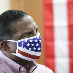Congressional candidate Burgess Owens listens as Donald Trump Jr. speaks to volunteers at Colonial Flag in Sandy on Thursday, July 23, 2020.