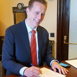 In this Monday, May 22, 2017 photo provided by the Utah State Elections office Tanner Ainge, son of Boston Celtics president Danny Ainge, files his paperwork at the Utah State Elections office in Salt Lake City to run in a special election for the seat of resigning U.S. Rep. Jason Chaffetz. (Utah State Elections Office via AP)