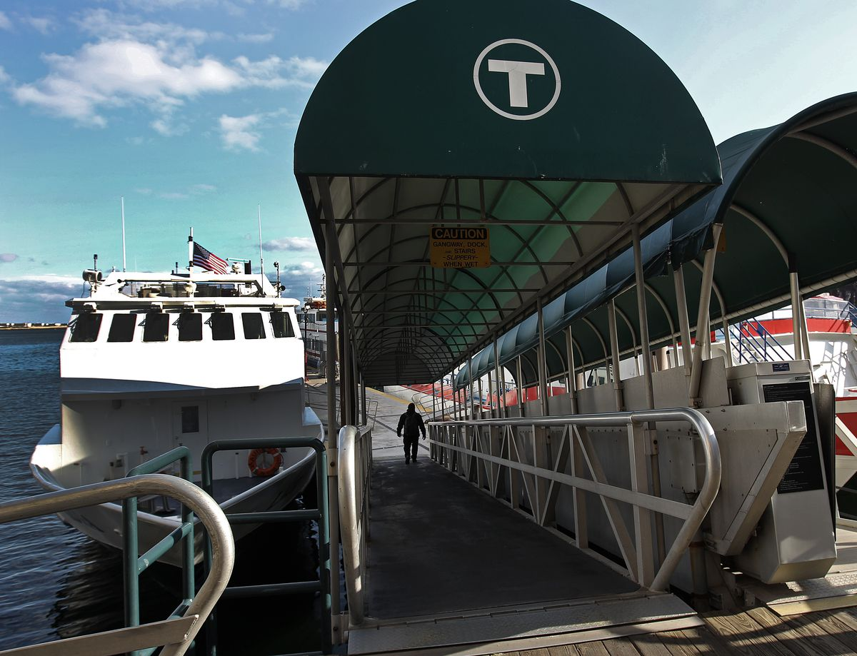 A ferry entrance, with awning over the platform leading to the ferry on the water.