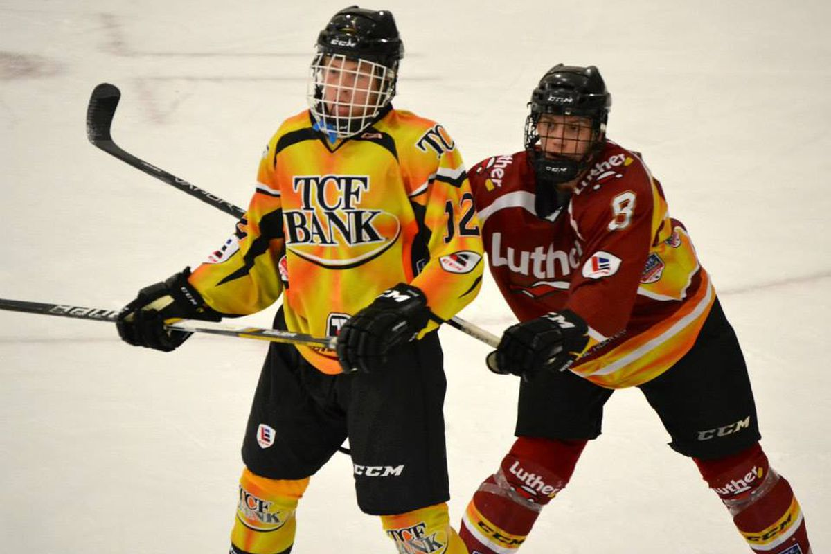Brock Boeser (left) battles for position in an Upper Midwest High School Elite League game last year.