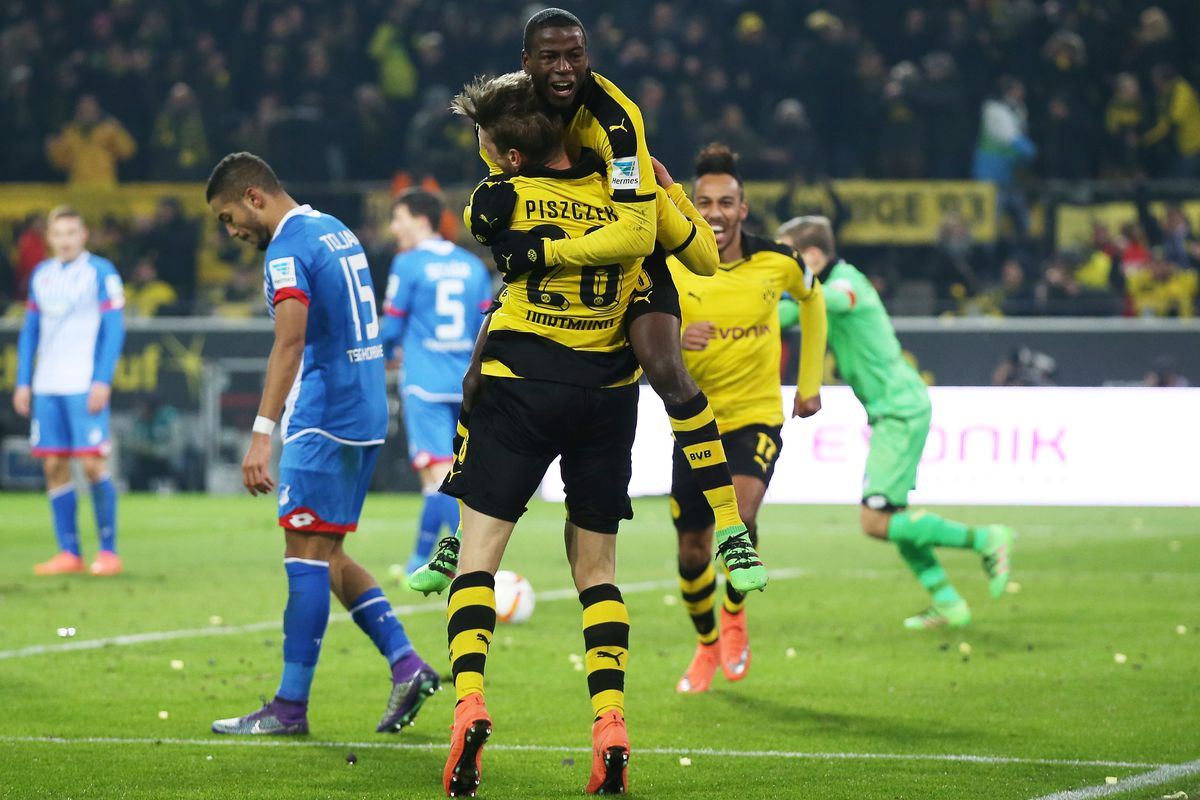 Lukasz Piszczek and Adrian Ramos celebrate after combining to give Dortmund the lead