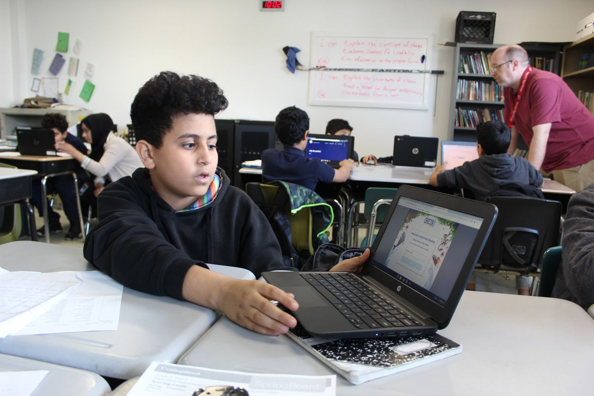 A student at Bridge Academy West in Detroit shows off a computer program designed for students who speak English as a second language.