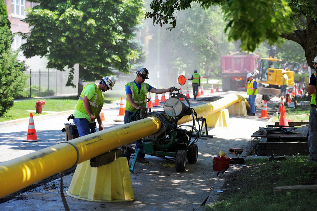 A Peoples Gas crew installing a new gas main in Albany Park last summer. The utility is undertaking a massive overhaul of its pipeline system, a yearslong project its customers are paying for.