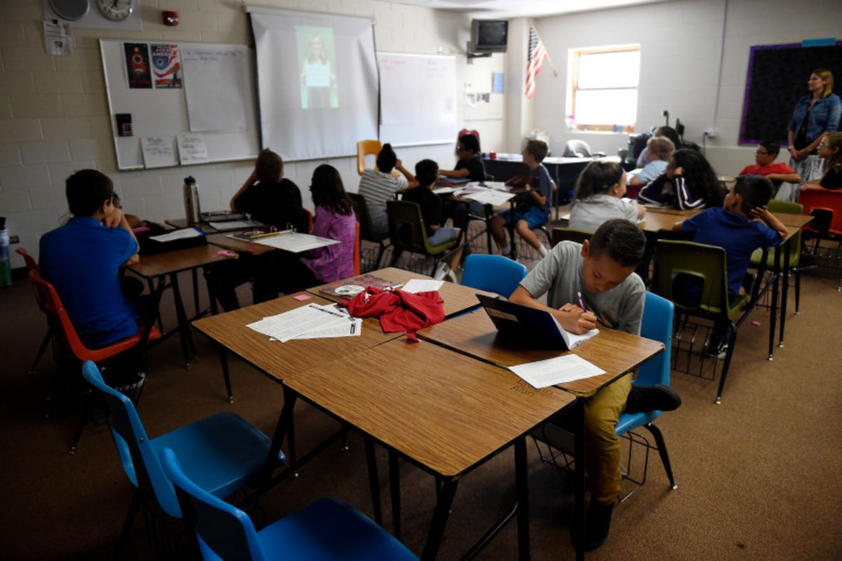 Students in Alicia Marquez's 6th grade science class at Overland Trail Middle School in Brighton watch a video and work on home work in August 2017. (Photo by Seth McConnell/The Denver Post)