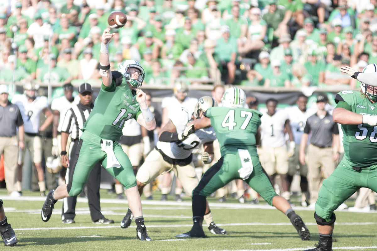 Michael Birdsong (11) fires a pass in Marshall's 41-31 win over Purdue last season.
