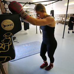 Boxer Whitney Gomez gets a rest during her workout at Fullmer Brothers Boxing Gym in South Jordan on Wednesday, June 7, 2017.