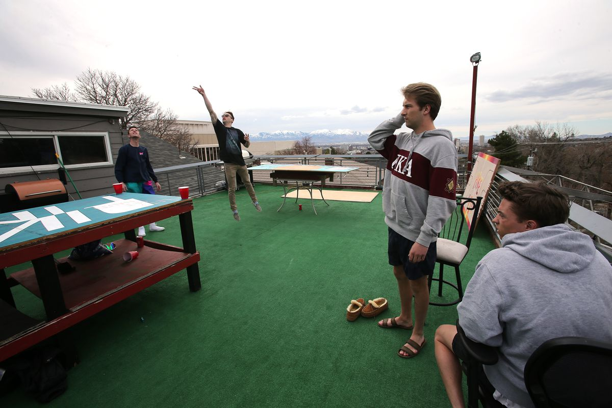Quinn Stagg, president of Pi Kappa Alpha fraternity at the University of Utah in Salt Lake City, joins his brothers on the roof of the fraternity house on Monday, March 16, 2020. Many members of the fraternity are moving out because of COVID-19.