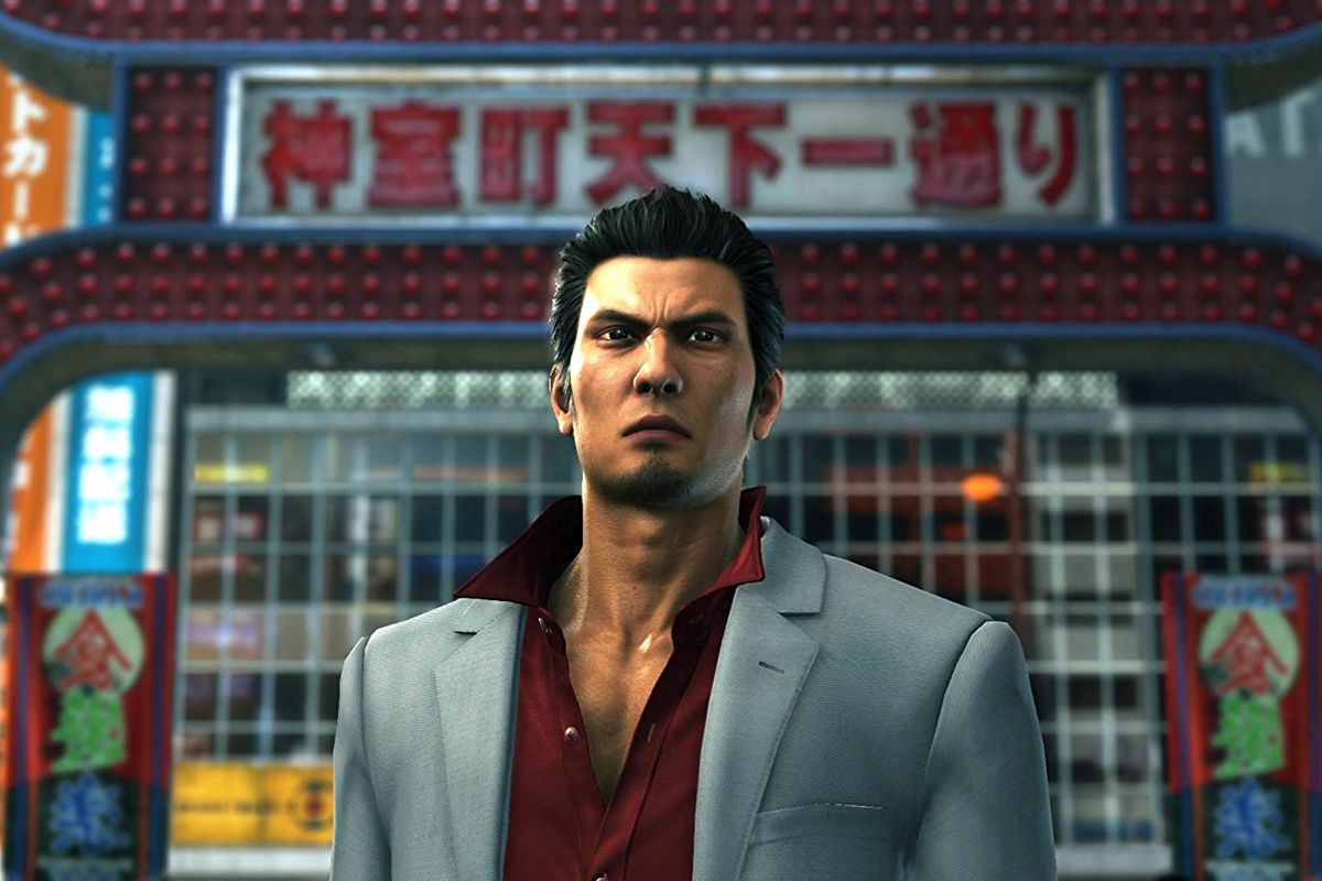 Kiryu stands in front of a gate in a screenshot from Yakuza 6: The Song of Life