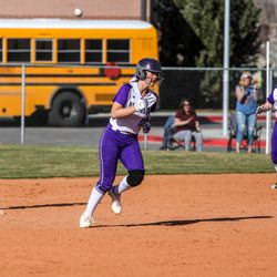 Lehi Pioneers' Brooklyn Wiltbank (11) and Halley Payne (14) run around the bases after Payne hit a home run during a high school softball game at Timpanogos High School on Thursday, April 1, 2021.